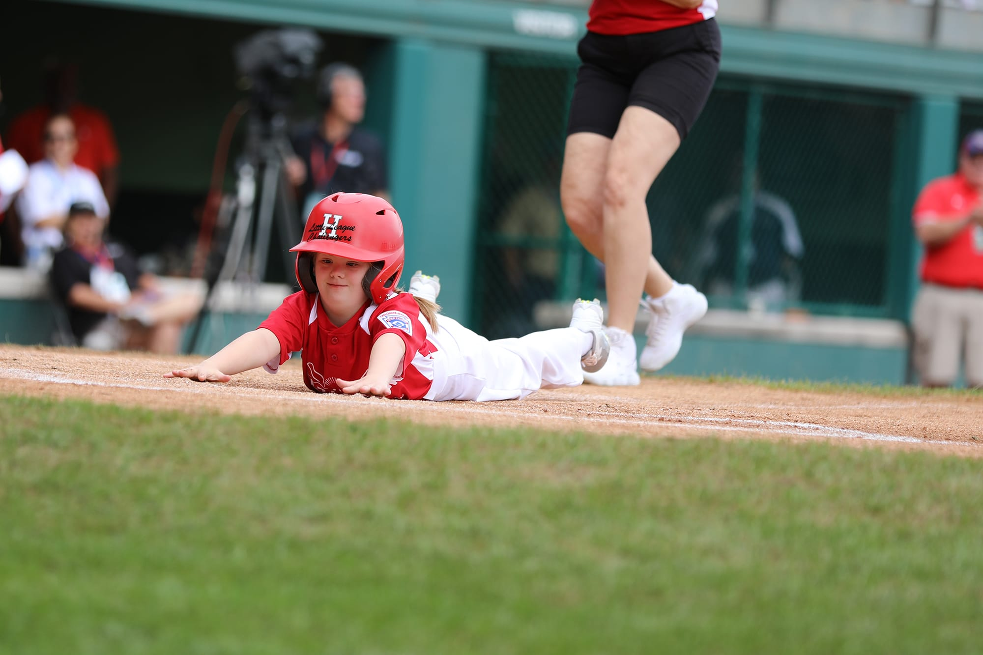 challenger game - player sliding into homeplate