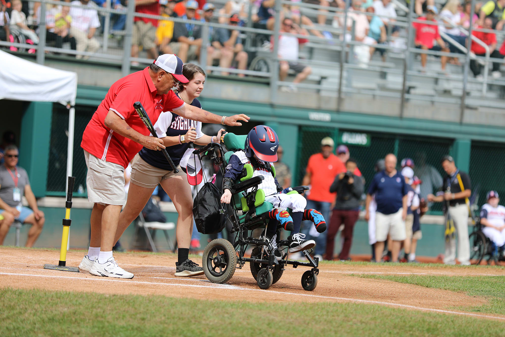 challenger game - buddy pushing player in wheelchair