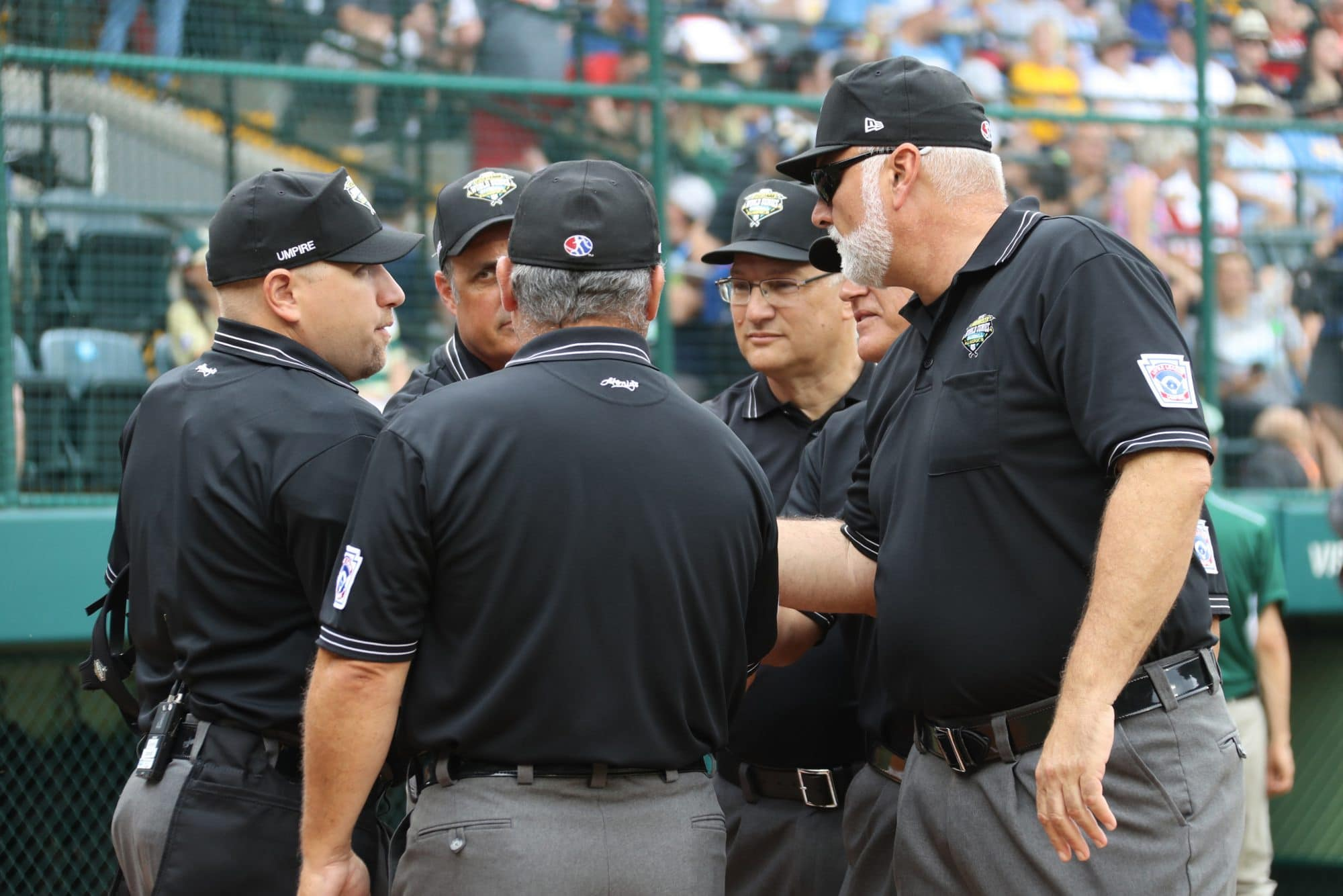 2018 LLBWS Umpires Gathered at Home Plate