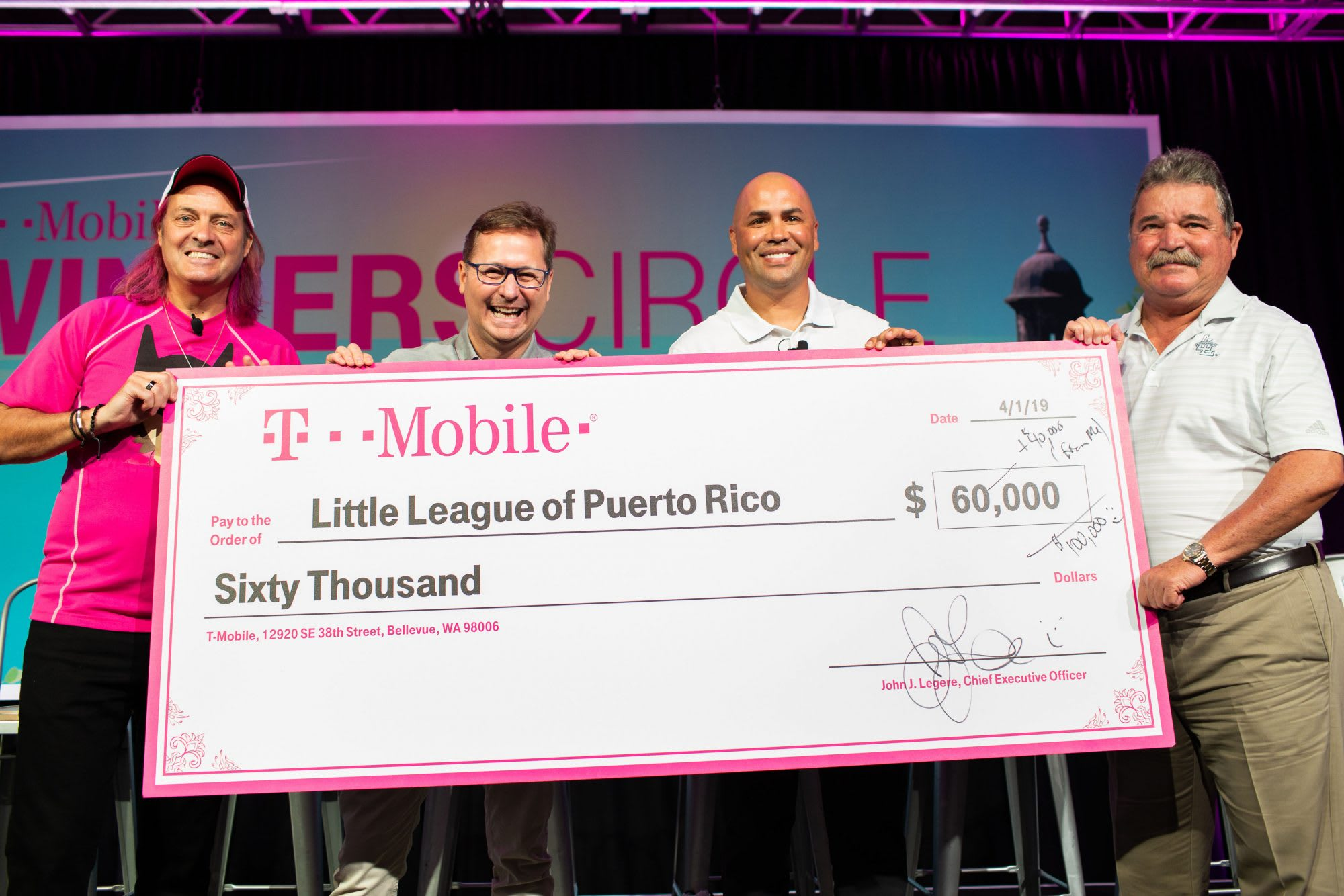 T-Mobile and LL Representatives Accept Giant Check for Local League Grants