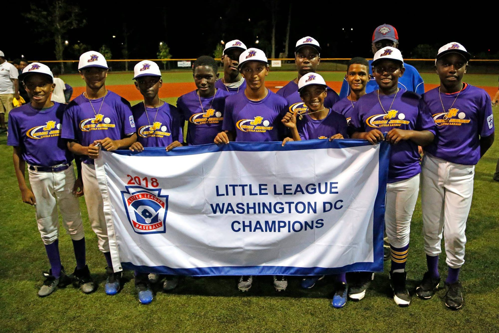 Mamie Johnson Little League Holds Championship Banner