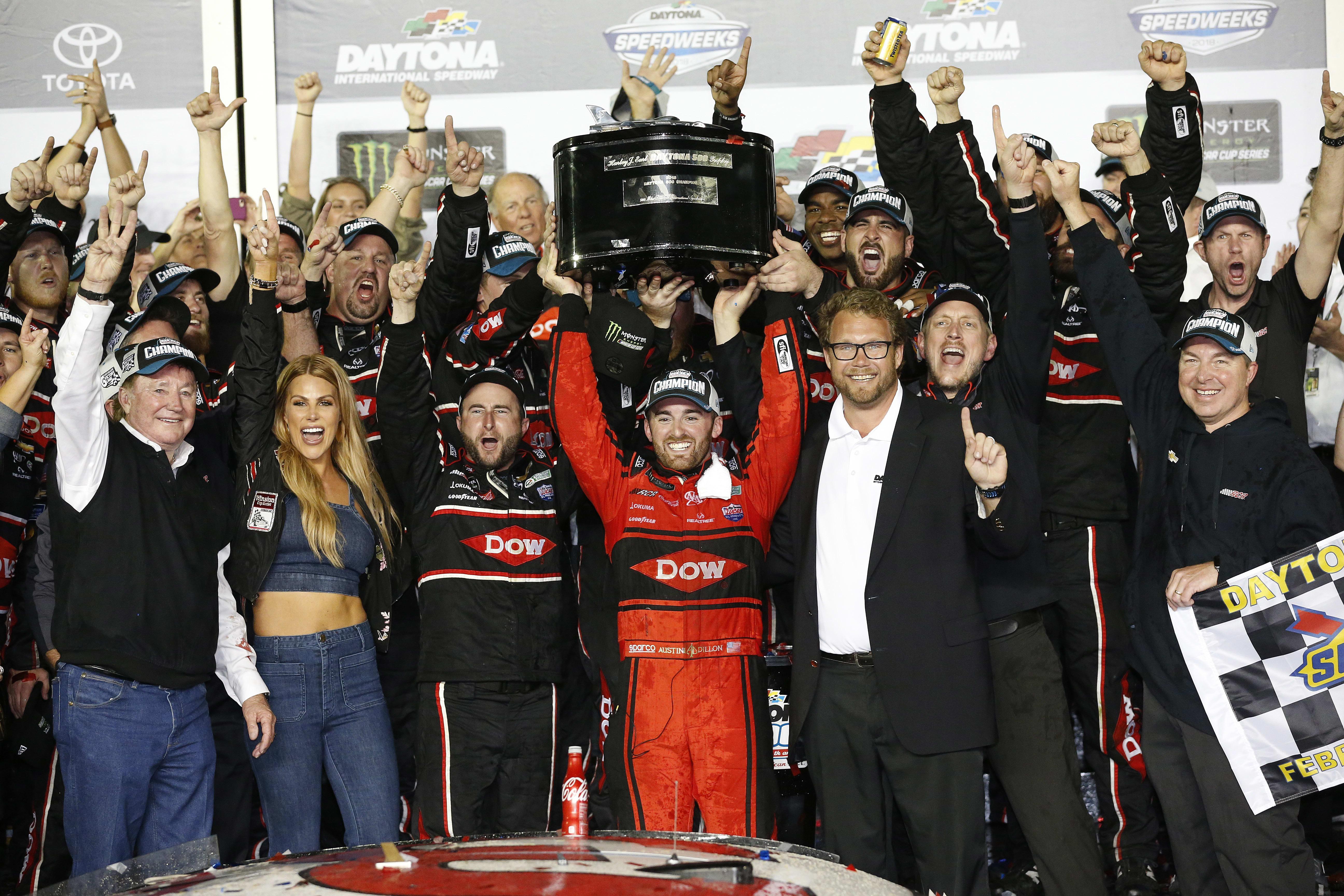 Austin Dillon raising the trophy.