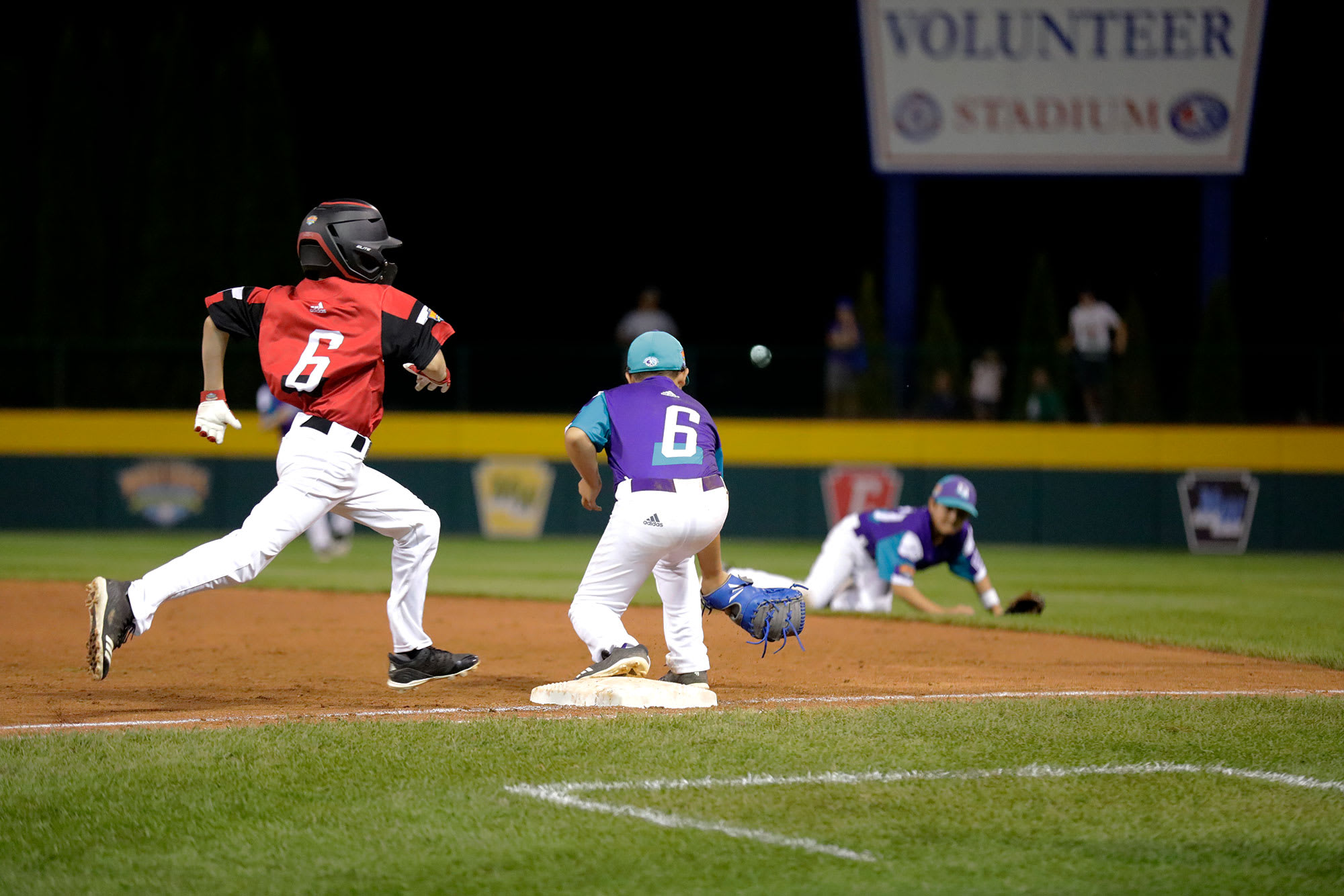 Canada player running towards base