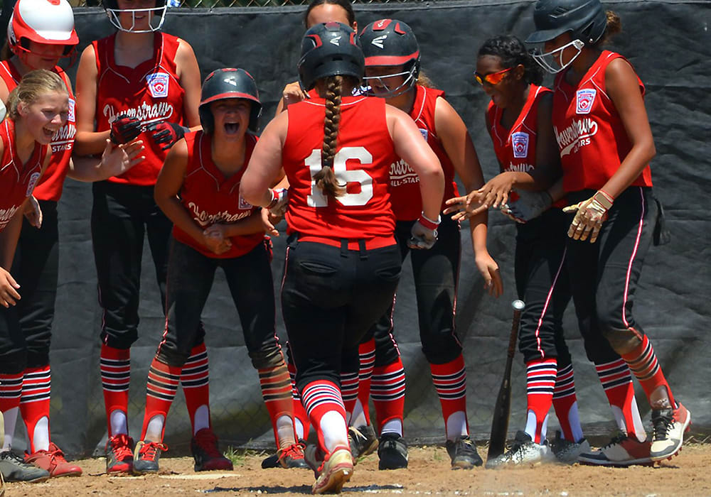 sb players celebrating at home plate