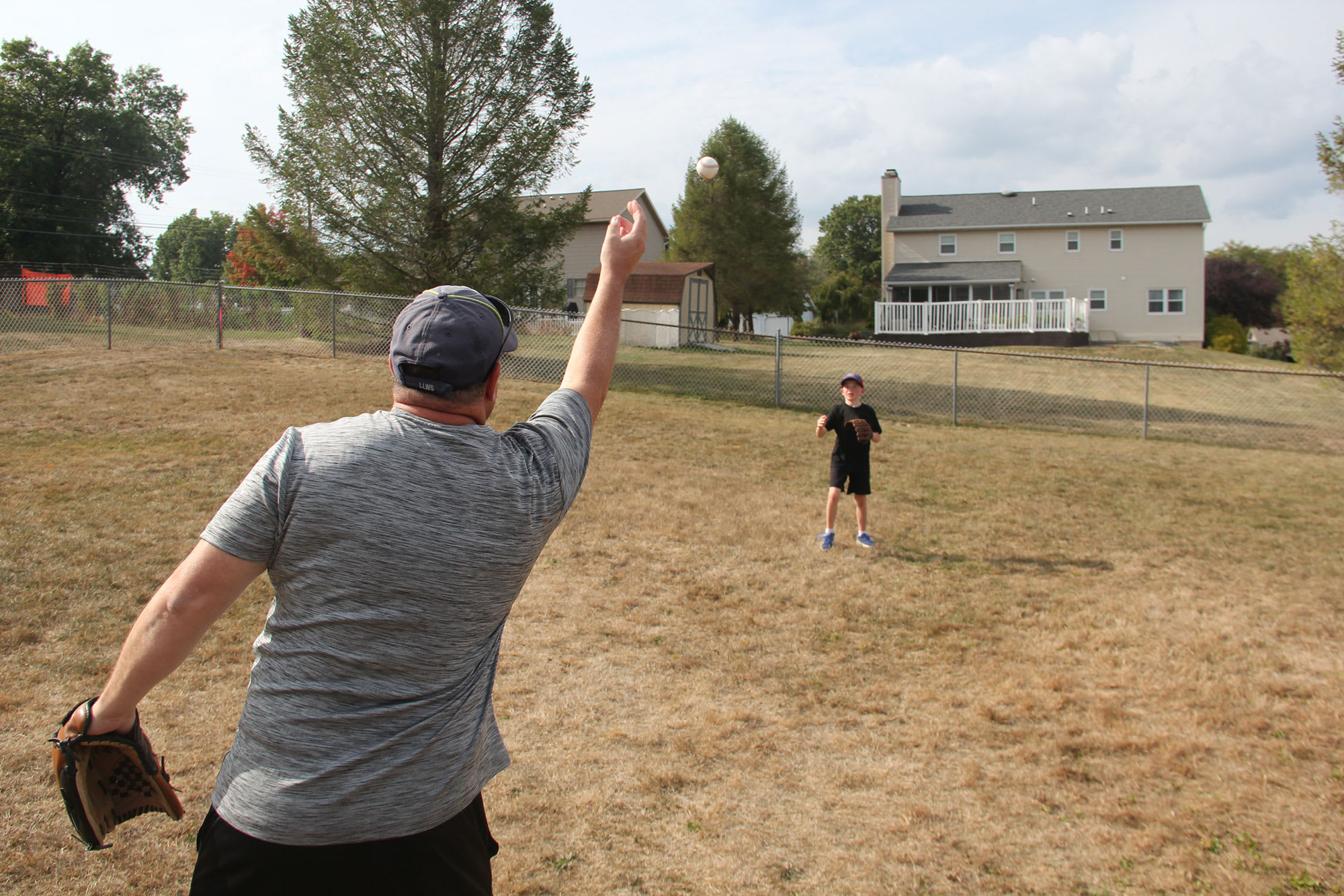 adult tossing ball