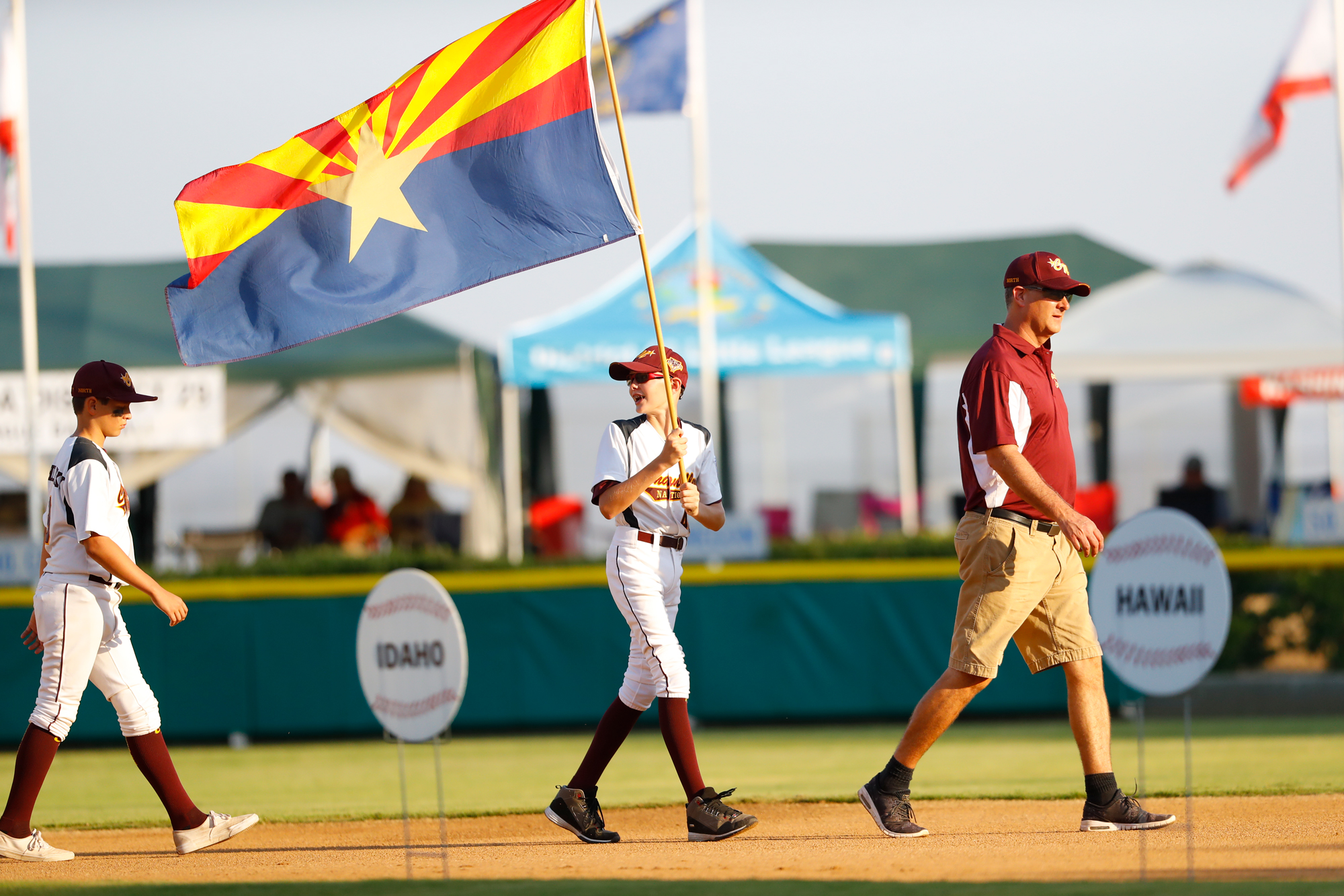 west-region-opening-ceremonies-players-holding-flag