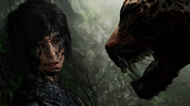 A jaguar growls in Lara Croft's muddy face in Shadow of the Tomb Raider
