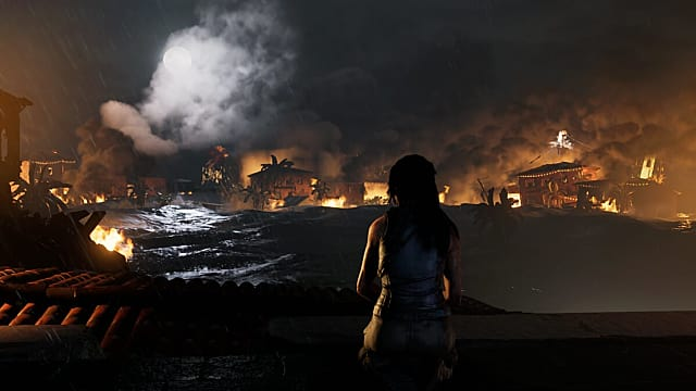 Lara Croft overlooks a city devastated by a tsunami in Shadow of the Tomb Raider
