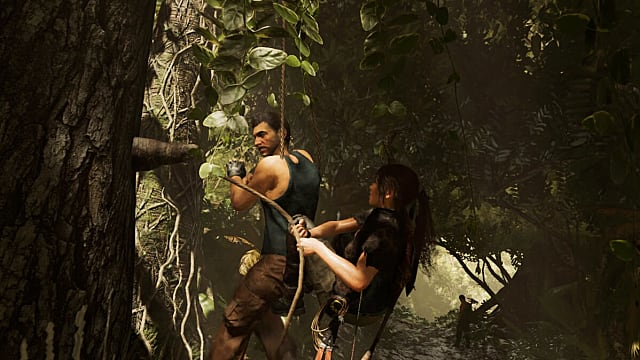 Lara hangs an enemy from a tree in the jungle