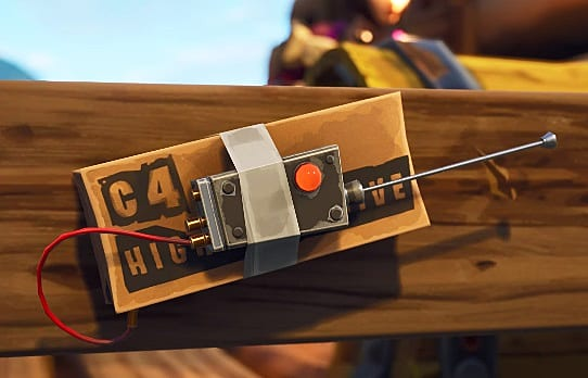 C4 attached to a board in Fortnite