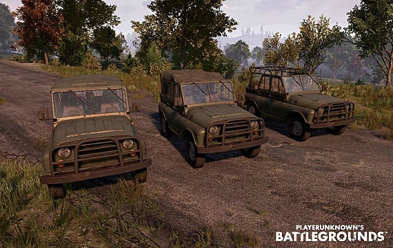 Three green jeeps line up along a road in PUBG