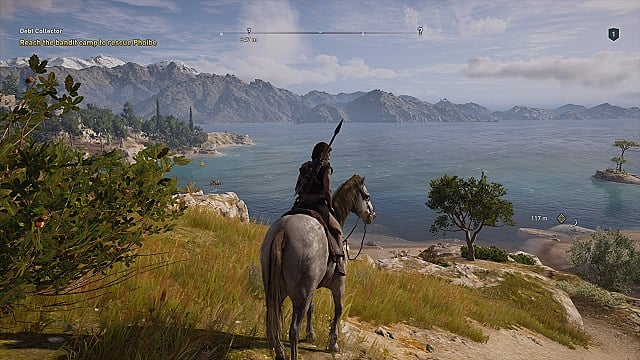 Cassandra sits on a white horse overlooking a bay in Greece