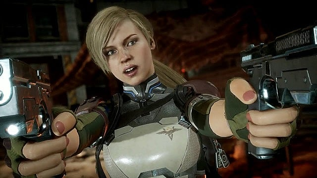 Cassie Cage holds two pistols