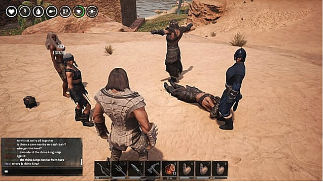 A group of warriors stands in a circle in the desert