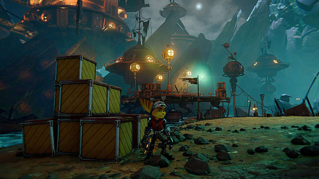 Ratchet wearing a visor and standing in front of a stack of crates on a dark beach.