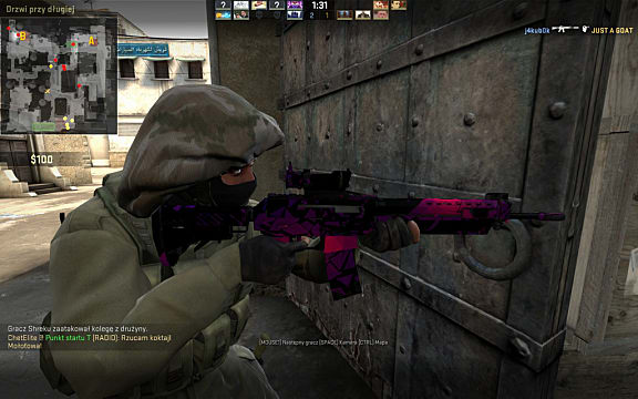 side profile of a CS:GO player holding a rifle with pink highlights