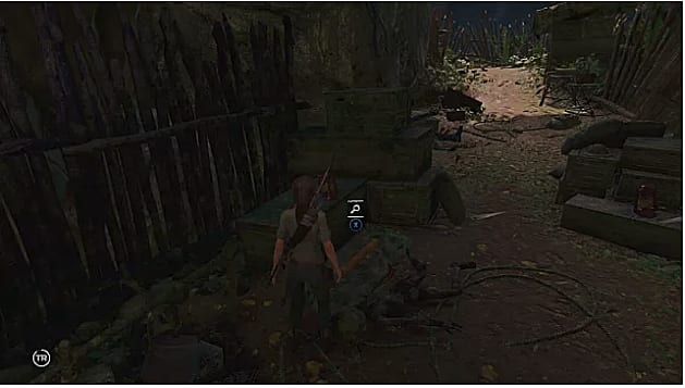 Lara finds the fourth document near a dead body on the ground
