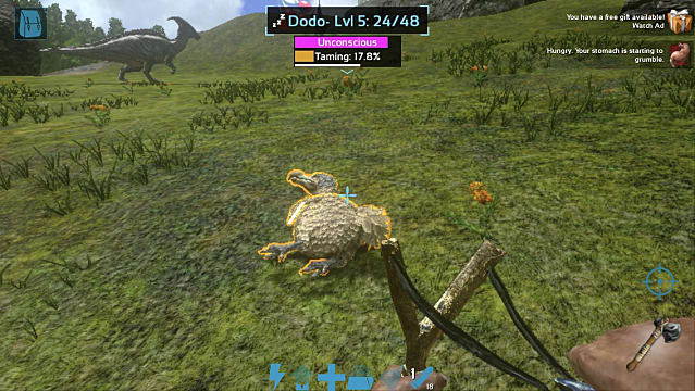 A players knocks out a Dodo with a slingshot