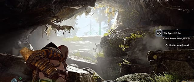 Kratos looking toward the opening of a cave