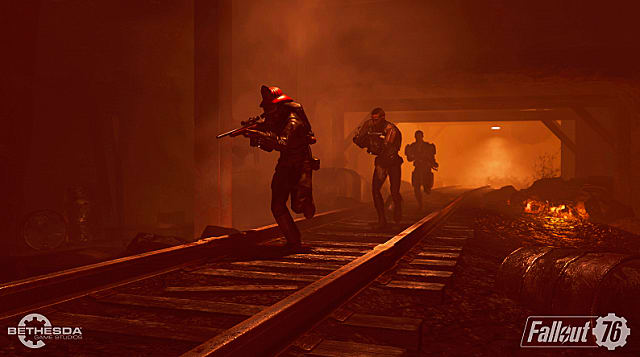A group of three players runs down a red, underground railway tunnel with guns drawn