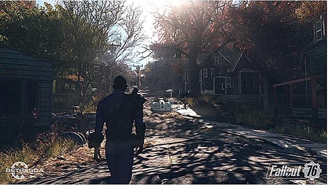 a vault dweller wearing a blue vault uniform walks away from the camera into a dilapidated town