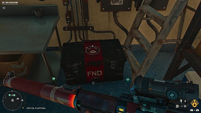 Red and black FND cache on the ground.