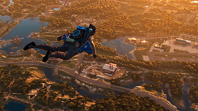 Dani using the wingsuit to fly over Yara at sunset.