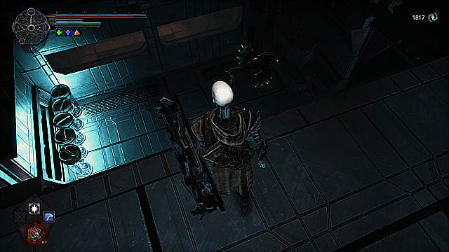 The player stands on a metal ledge overlooking a room with green fish enemies and clear cylinders of bright blue light.