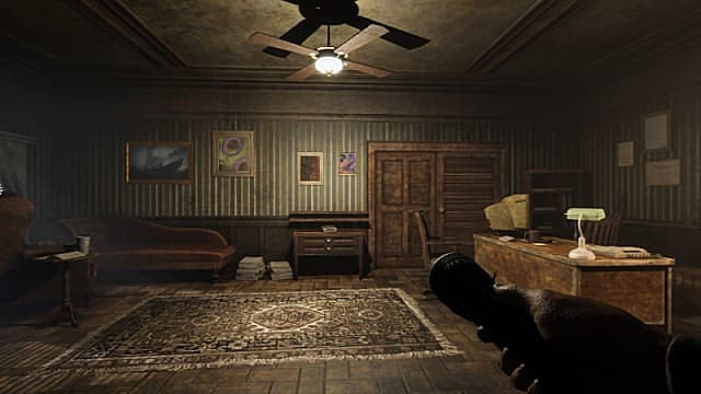 Player character holding a flashlight in a well-lit home office.