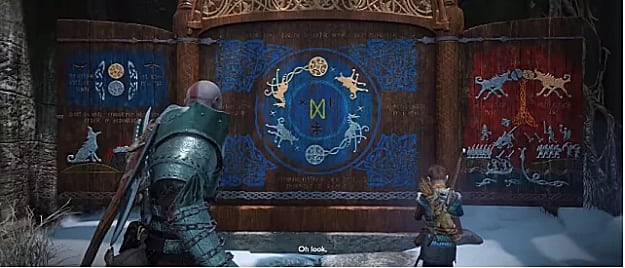 Kratos and the boy stand in front of the Wildwoods Jotnar Shrine, which is blue in the middel and left and red on the right; painted in ornate symbols
