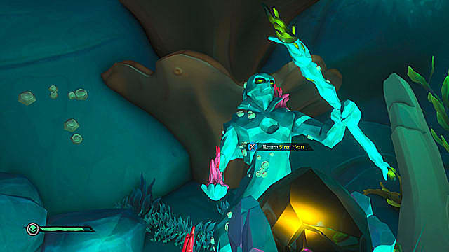 A green siren statue holding a staff in its left hand.