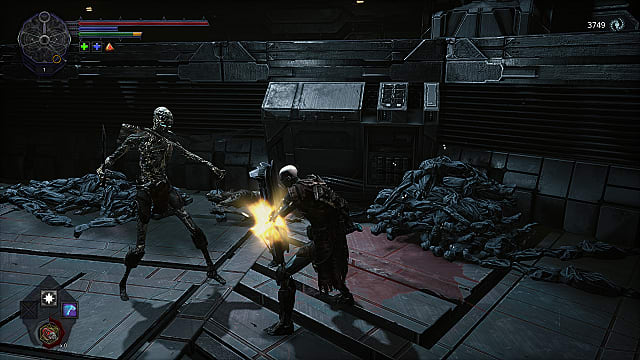 The Spawn using a tower shield to parry a decaying, boney enemy next to a pile of corpses.