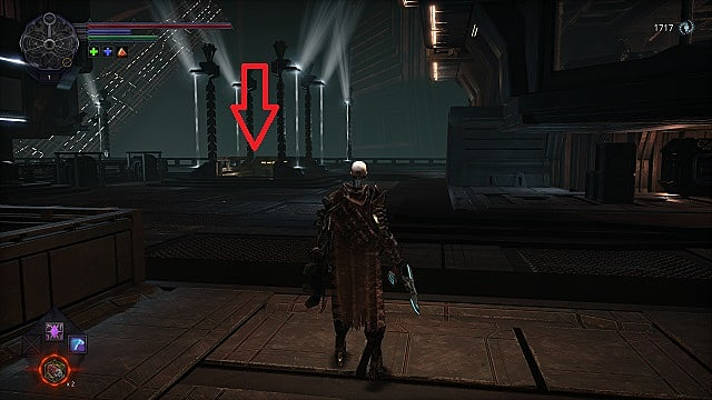 The spawn standing in a large, stone square looking toward a stairwell surrounded in bright lamposts.