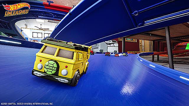 A yellow van with a Teenage Mutant Ninja Turtles vanity plate racing on a blue track.