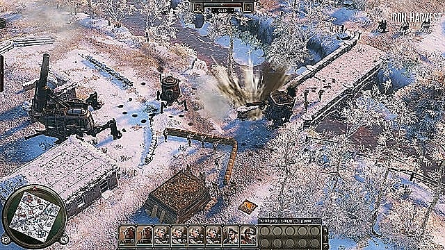 A bi-pedal mech leads three footsoldiers across a bridge to attack other mechs on a snowy map.