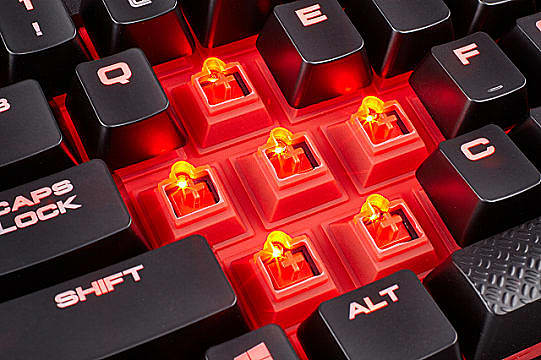 Close up of the K68 RGB's rubber protective coating surrounding Cherry MX Red switches