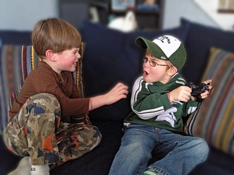 kids-fighting-over-game-2052c.jpg