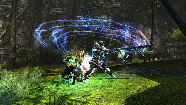 Knight swinging sword in a forest while attacking a creature.