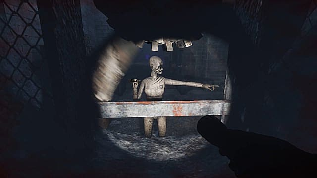 Player shining a flashlight on a mannequin that's pointing right.