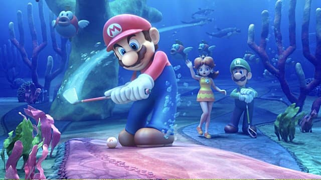 Mario teeing off on an underwater course, with Princess Daisy and Luigi standing behind him.