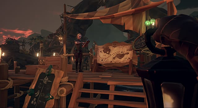 A man stands in front of a map at the Merchant Alliance in Sea of Thieves