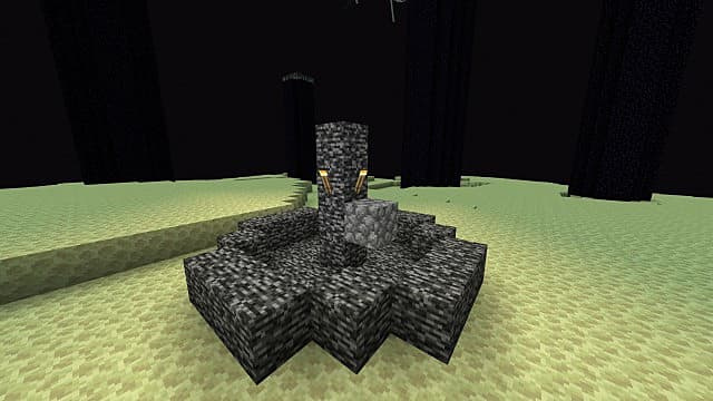 A bedrock fountain with torches in a desert biome in Minecraft.
