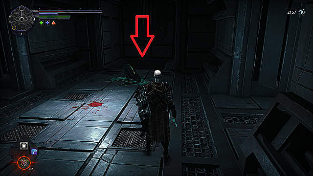 The spawn stands in a metal room with a dead fish enemy on the floor covered in green blood.