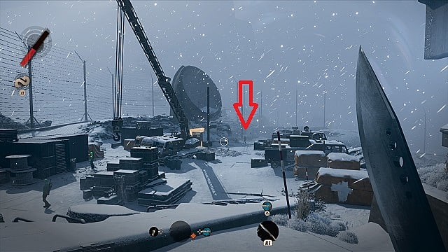 A construction area in the snowy afternoon section of The Complex, player's machete in right side of frame.