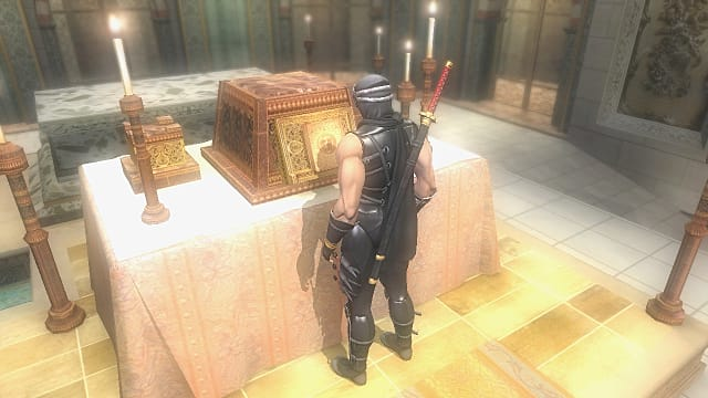 Ryu standing in front of table with candles and gold box with Book of Eons.