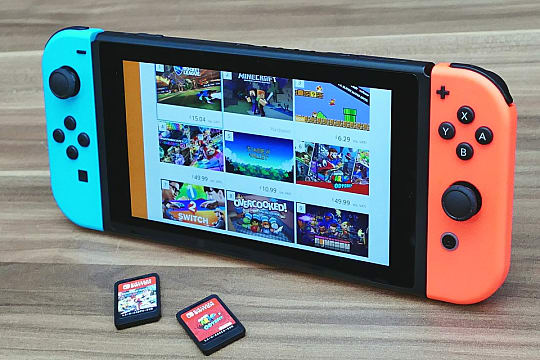 Nintendo Switch with neon red and blue Joy Cons