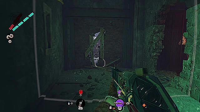 A boarded up door in dark room.
