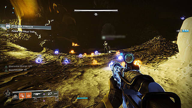 Player holding Gnawing Hunger assault rifle, looking at blue and red orbs on Mars near piles of bones.