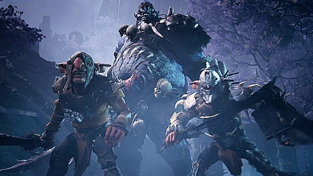 Two goblins in leather and bone armor standing in front of a large orc in the snow.