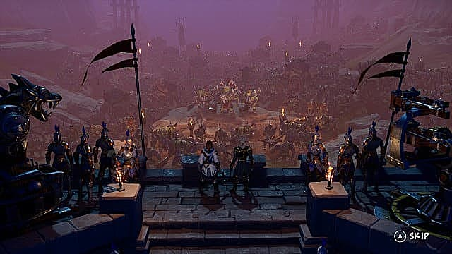 A human army stands on a castle rampart overlooking orcs below.